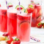 Frisky Summer Fruit Punch - a delicious fruit punch made with cucumber and apple bison grass vodka, prosecco and fruit. The perfect summer drink for parties, BBQ's and more. It's so quick and easy to make, you'll be making this punch all summer long!
