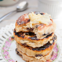 Lemon Welsh Cakes with Honey Ginger Whipped Butter - a traditional Welsh tea time treat. Delicious little cakes filled with raisins and cooked on a griddle. Take an untraditional turn by adding a touch of lemon, and serve warm with Honey Ginger Whipped Butter