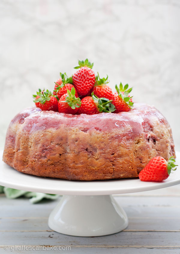 Strawberry Cheesecake Upside Down Bundt Cake - a delicious and moist yogurt cake with creamy strawberry cheesecake and fresh strawberries baked right into it. So easy, so yummy and perfect for summer! #YumOfTheMonth #YOTM