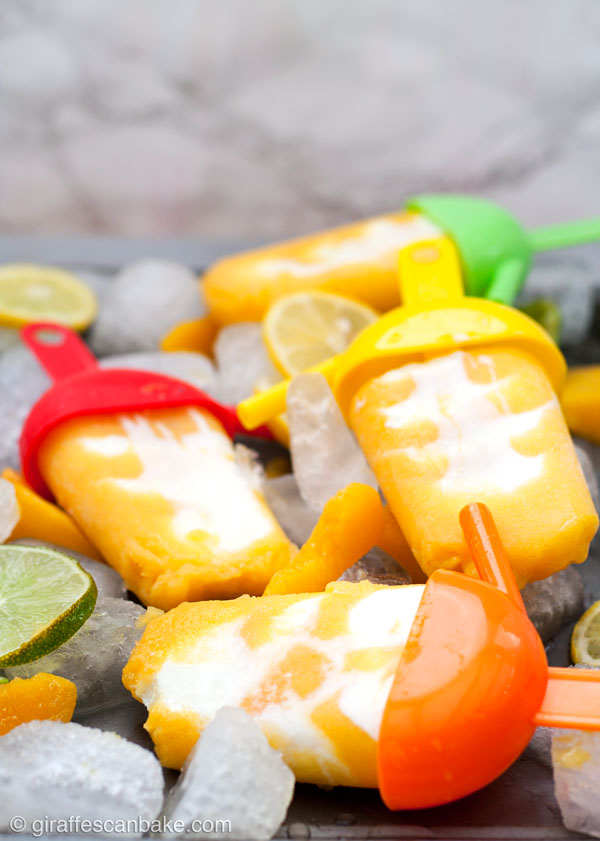 Peaches 'n' Cream Margarita Popsicles -Creamy and fruity, with just a hint of tequila - these Peaches 'n' Cream Margarita Popsicles are really easy to make and are the perfect treat for Cinco de Mayo and all summer long!