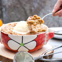 Rhubarb and Apricot Crumble - a really easy summer dessert, with tangy rhubarb, sweet apricots and a crunchy, buttery crumble topping. All the flavours of summer, with a comforting satisfaction.