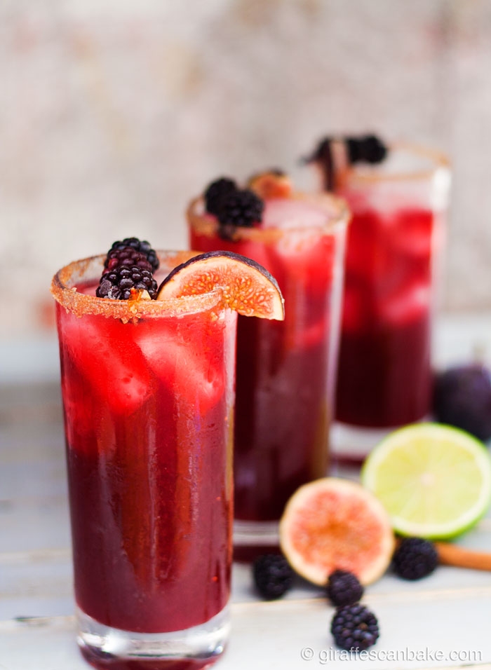 Blackberry, Cinnamon and Fig Margarita - Three margaritas in tall glasses in a diagonal row