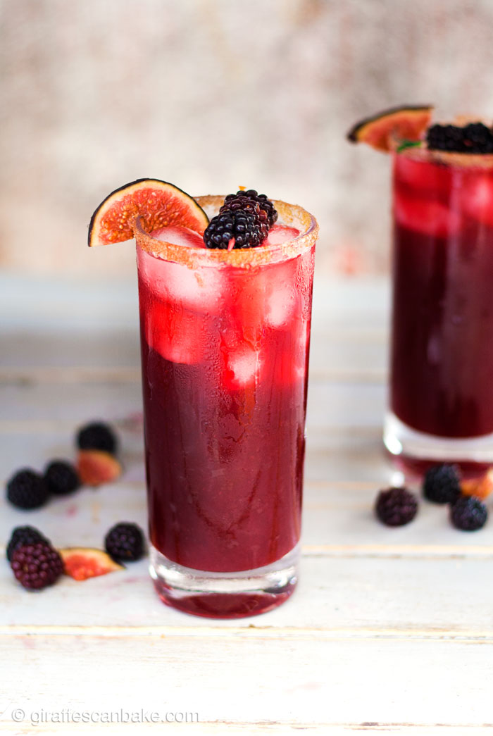 Blackberry, Cinnamon and Fig Margarita - one margarita in a tall glass, another margarita is in the background