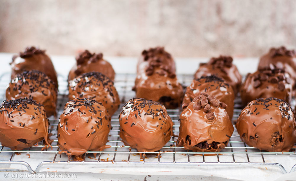 Gluten Free Cookie Dough Brownie Bombs with Salted Caramel - three rows of brownie bombs on a wire rack