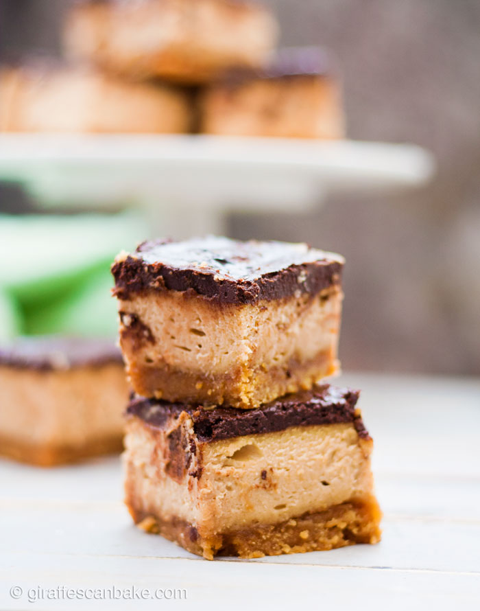 Gluten Free Peanut Butter Cheesecake Bars - These Gluten Free Peanut Butter Cheesecake Bars have a flourless peanut butter cookie base, with a creamy cheesecake loaded with tonnes of peanut butter, and topped with a rich and silky chocolate ganache. These cheesecake bars are so easy to make, and naturally gluten free so no fancy, expensive ingredients are needed! They're a must try!
