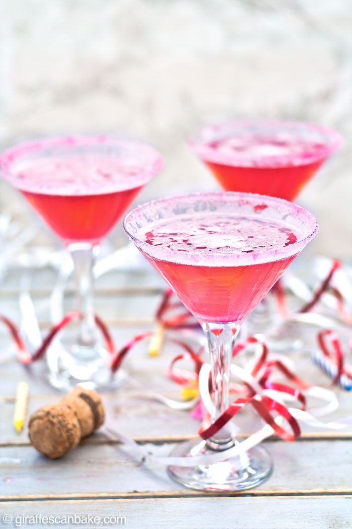 The Rory Cocktail is a very pink drink, made from pineapple vodka, grenadine and champagne or prosecco, served in a martini glass with a pink sugar rim! A really fun, easy and yummy cocktail to celebrate the return of Gilmore Girls with cocktails and girl power!!