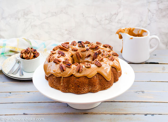 Gluten Free Brown Sugar and Pecan Caramel Bundt Cake - This Gluten Free Brown Sugar and Pecan Caramel Bundt Cake is packed full of pecans and toffee bits, with a moist and tender crumb, smothered in thick, gooey caramel, topped with butter toasted pecans!