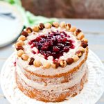 """A deliciously tempting mini 6"""" cake that is naturally gluten and dairy free! Moist hazelnut cake with plum filling and dairy free cinnamon frosting. It's delicious and easy to make, with no oil needed!"""