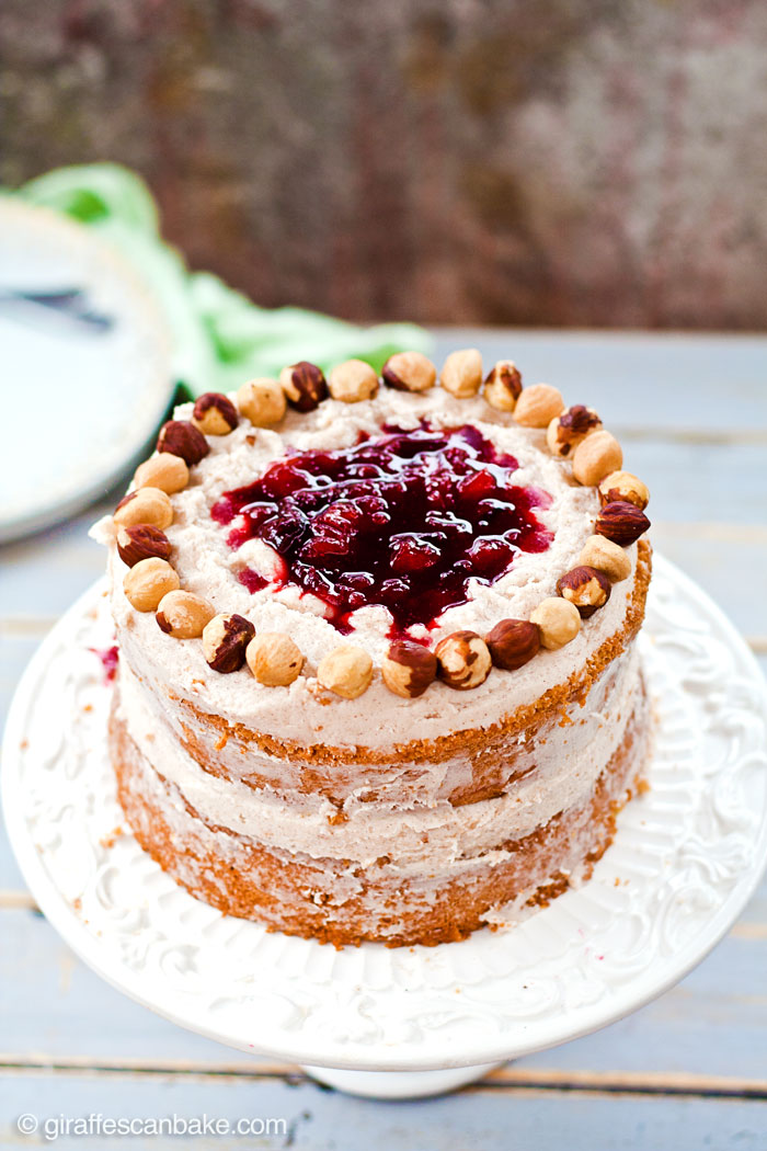 "A deliciously tempting mini 6"" cake that is naturally gluten and dairy free! Moist hazelnut cake with plum filling and dairy free cinnamon frosting. It's delicious and easy to make, with no oil needed!"