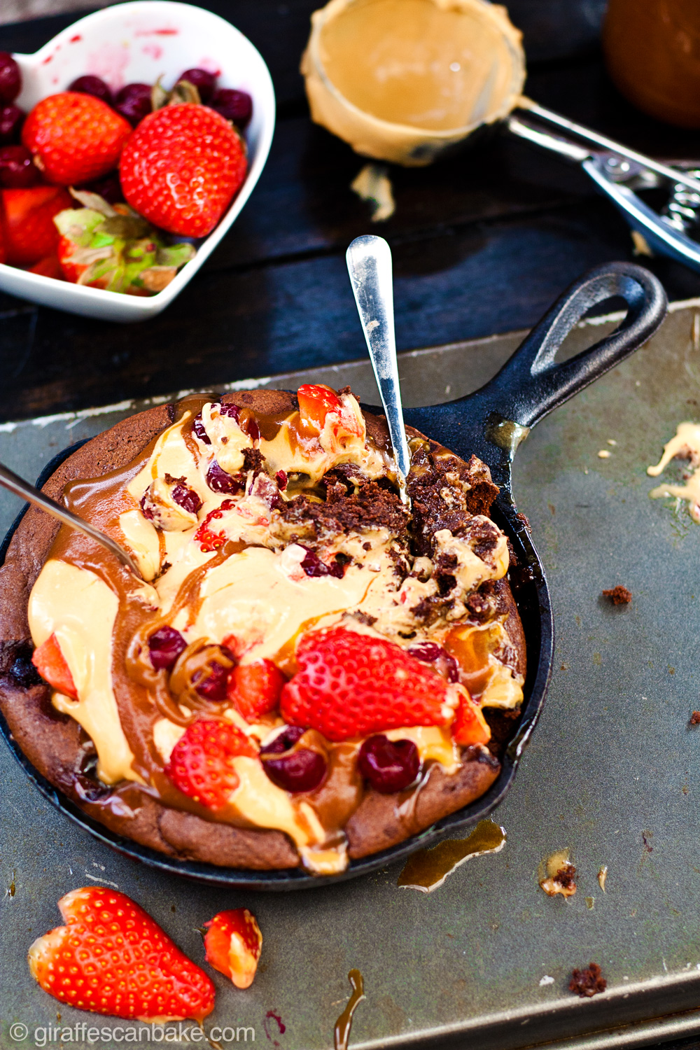Brownie Sundae for Two - The most delicious way to wow your Valentine this year! This Gluten Free Skillet Brownie Sundae is made especially for two to share (loving gazes across the sundae are optional). Amaretto soaked cherries are baked into a fudgy, chocolate skillet brownie, which is then topped with an easy, no-churn salted caramel ice cream and amaretto caramel sauce. It's then finished off with delicious fresh berries for the most amazing brownie sundae you could ever want. And the best part? It's made right in your Vitamix blender and takes no time at all!