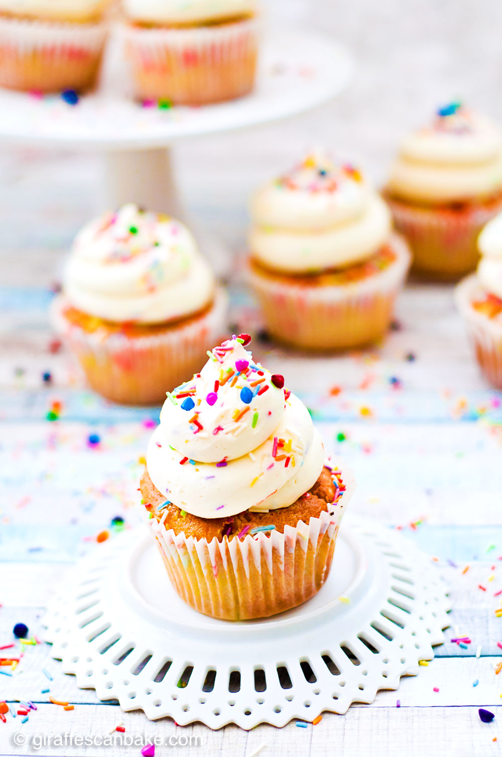 Fluffy vanilla gluten free cupcakes loaded with sprinkles, topped with delicious whipped vanilla buttercream and even more sprinkles. These Funfetti Cupcakes are the perfect way to celebrate my (or your) birthday!