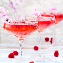 Peach vodka, fresh raspberry syrup and champagne are combined to make this gorgeous Mother's Day Raspberry Peach Champagne Cocktail. Sweet, bubbly and full of fresh, fruity flavours, this is the perfect cocktail to serve at a Mother's Day brunch or any special occasion. Don't have peach vodka to hand? No problem, I have an easy substitute for you! So raise a glass and let's call a toast the wonderful Mother figures in our lives.