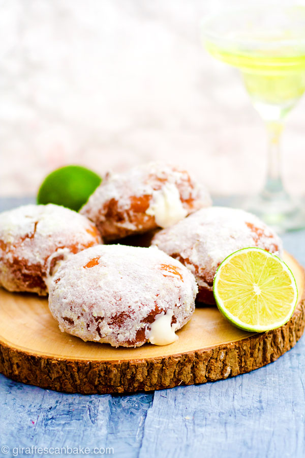 Gluten Free Yeast-Raised Margarita Donuts - fluffy, delicious and so easy! This amazing recipe also includes all my tips on how to make perfect gluten free yeast-raised donuts every time. Plus a FREE cheat sheet printable! - four donuts on a wooden board