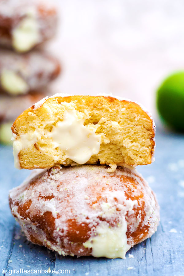 Gluten Free Yeast-Raised Margarita Cheesecake Donuts - fluffy, delicious and so easy! This amazing recipe also includes all my tips on how to make perfect gluten free yeast-raised donuts every time. Plus a FREE cheat sheet printable! - a donut with a bite taken out of it on top of a whole donut