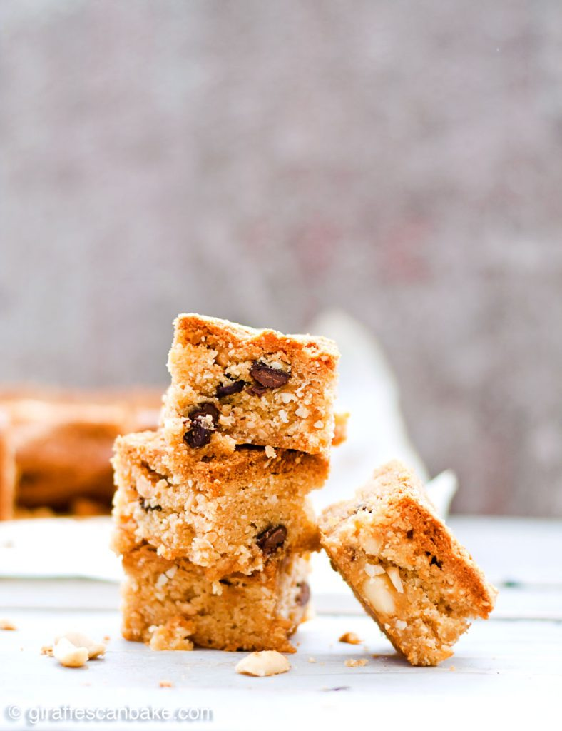 Gluten Free Triple Peanut Blondies - Chewy, moist and packed full of delicious peanut goodness. A peanut butter lover's dream come true! - A tower of three blondies