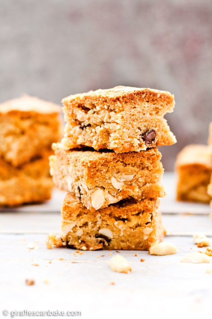 Gluten Free Triple Peanut Blondies - Chewy, moist and packed full of delicious peanut goodness. A peanut butter lover's dream come true! - A tower of three blondies close up