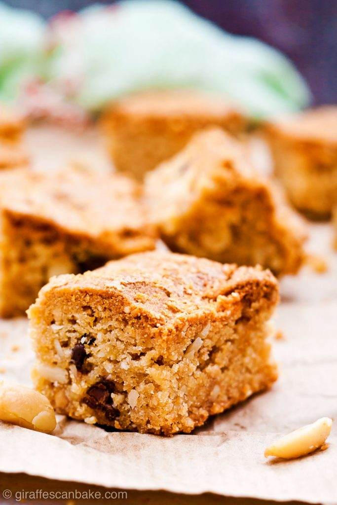 Gluten Free Triple Peanut Blondies - Chewy, moist and packed full of delicious peanut goodness. A peanut butter lover's dream come true! - Close up of one blondie