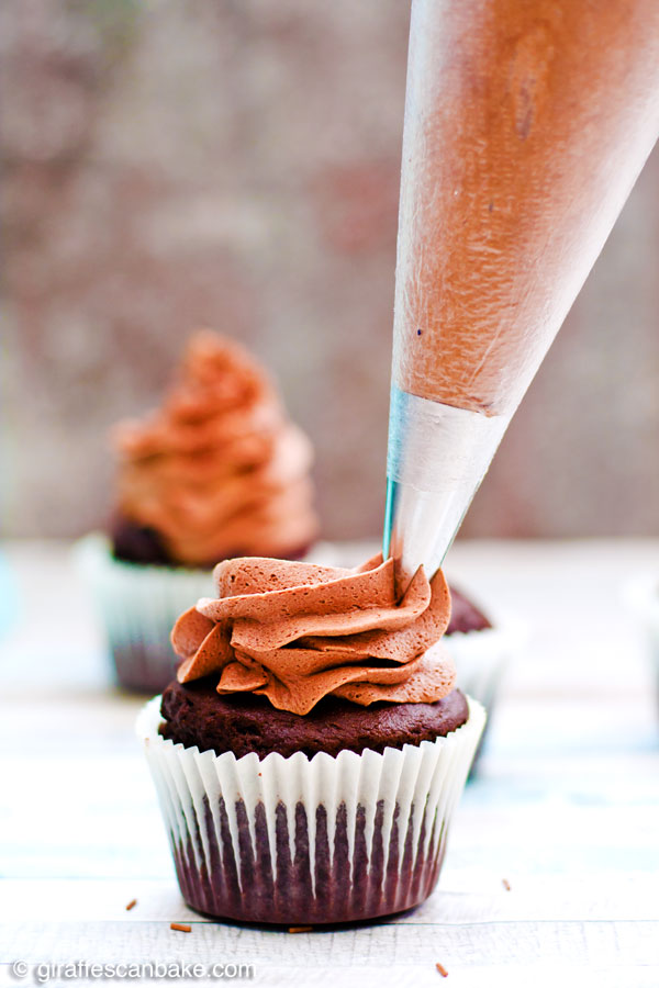 """This is, hands down, the BEST Chocolate Buttercream Frosting, ever! It's smooth, fluffy, creamy, and oh so chocolatey. My special """"secret ingredient"""" really takes it to the next level. Once you've tried this recipe, you'll never turn back!"""