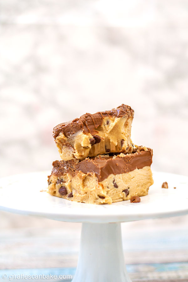 These Gluten Free Peanut Butter Cookie Dough Bars are decadence at its finest! Soft, delicious gluten free cookie dough is combined with peanut butter, made into a bar and topped with chocolate and peanut butter combined. They're no bake, so easy to make, and absolutely yummy!