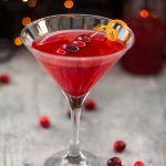 The Cranberry Martini is a sweet and slightly tart festive cocktail, made with a homemade cranberry shrub to give it a little bit of zing - cranberry martini with cranberry garnish, square cropped