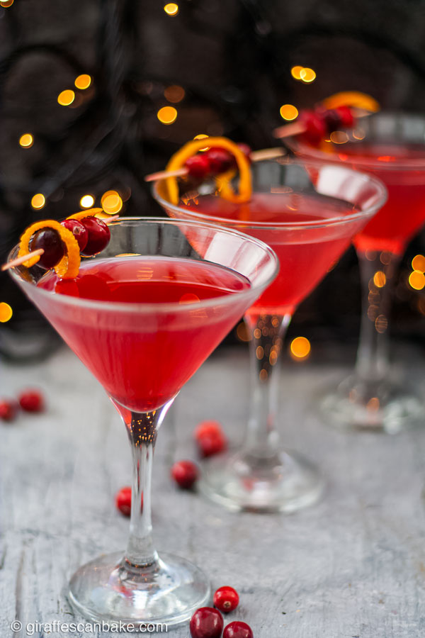The Cranberry Martini is a sweet and slightly tart festive cocktail, made with a homemade cranberry shrub to give it a little bit of zing - three cranberry martinis in a diagonal row