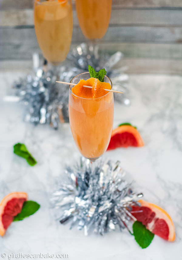 Brandy Grapefruit Mimosa - one mimosa with two in the background