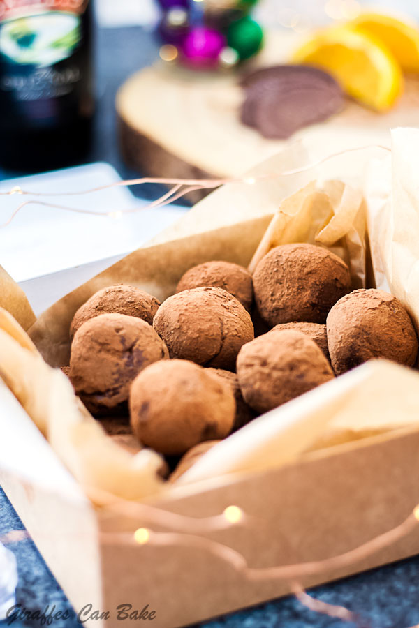 Chocolate Orange Baileys Truffles are a decadent chocolate treat everybody is going to love. Made with festive chocolate orange and rich, creamy Bailey's! - truffles in a gift box, close up