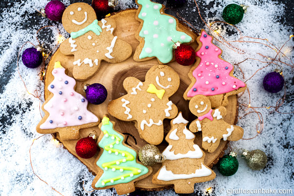 These buttery, melt in your mouth Gluten Free Shortbread Cookies with Cinnamon & Clementine are the perfect Christmas cookies - gingerbread man and christmas tree shaped cookies on a tree stump stand, full size