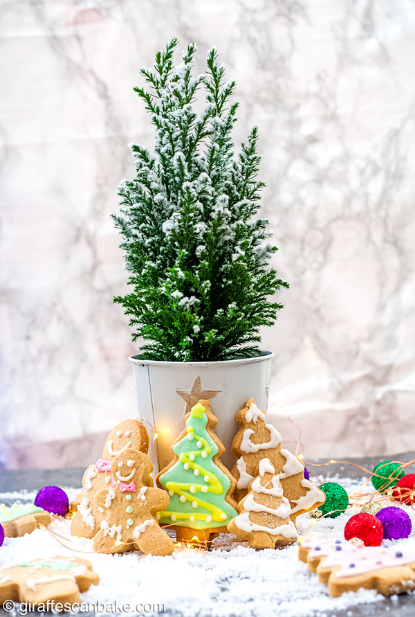 These buttery, melt in your mouth Gluten Free Shortbread Cookies with Cinnamon & Clementine are the perfect Christmas cookies - christmas tree and gingerbread shaped cookies around a mini christmas tree, full size photo