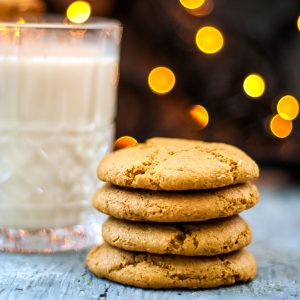Gluten Free Eggnog Cookies are thick and chewy, they're the ultimate Christmas Cookie. They're made with nutmeg and a healthy dose of bourbon so they're full of holiday cheer - a stack of eggnog cookies straight on, square cropped
