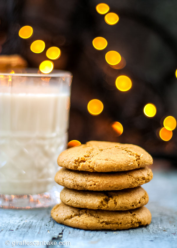 Gluten Free Eggnog Cookies are thick and chewy, they're the ultimate Christmas Cookie. They're made with nutmeg and a healthy dose of bourbon so they're full of holiday cheer - a stack of eggnog cookies straight on, with a glass of eggnog in the background