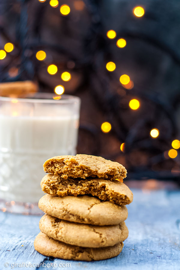 Gluten Free Eggnog Cookies are thick and chewy, they're the ultimate Christmas Cookie. They're made with nutmeg and a healthy dose of bourbon so they're full of holiday cheer - a stack of cookies, with one broken in half so you can see the chewy centre