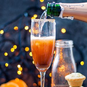 Mince Pie Christmas Mimosas - champagne being poured into the glass, square cropped