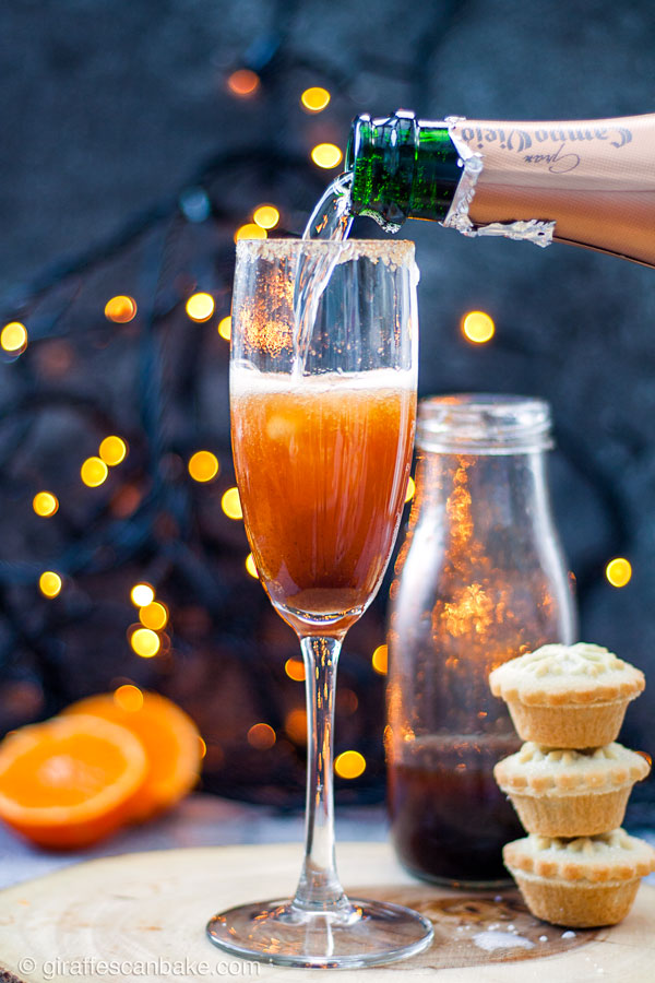 Mince Pie Christmas Mimosas - champagne being poured into the glass, full size