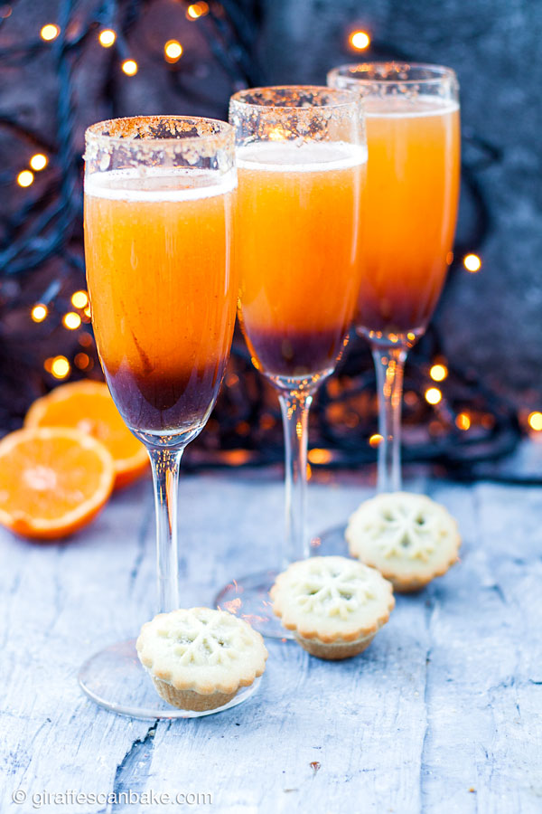 These Mince Pie Christmas Mimosas are the perfect holiday cocktail to enjoy on Christmas morning! They're made with a mince pie flavoured syrup, fresh clementine juice, and champagne. #mincepies #mimosas #brunch #christmas #holidays