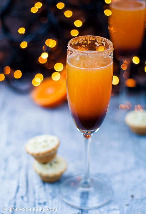 Mince Pie Christmas Mimosas - one mimosa with some mince pies behind it