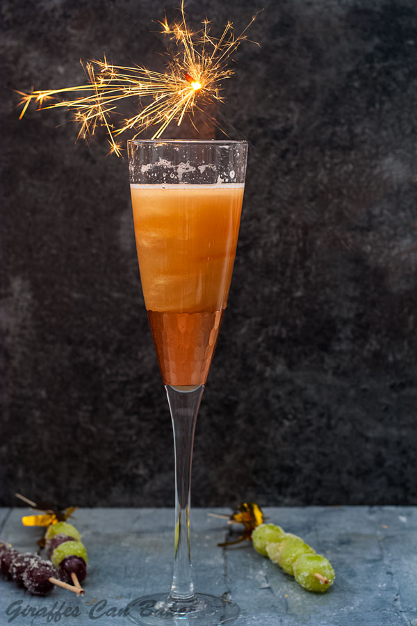 Shimmery New Years Eve Cocktail - filled champagne glass with sparkler over the top